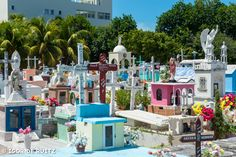 Isla Mujeres, Mexico This is the most colorful cemetary I've seen!