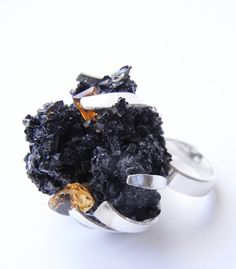 Claw ring in silver with crushed Onyx and Hematite and 3 cut Citrine. Kelvin J. Birk 2014