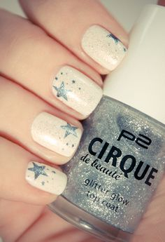 These pretty sparkly silver star nails. Simple and sweet :)