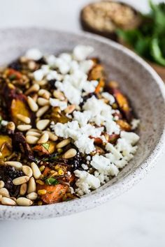 brown rice salad with spice-roasted carrots, feta and pine nuts.