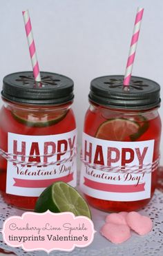 These DIY mason jars are wrapped with a Tiny Prints Valentine's Day Card, secured with bakers twine and topped off with a cute lid and straw!