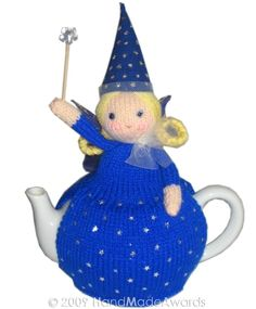Ravelry: The Blue Fairy pattern by Loly Fuertes Tea Cosy Knitting Pattern, Baby Knitting, Knitted Tea Cosies, Teapot Cover, Crochet Fairy, Art And Hobby, Blue Fairy, Tea Cozy, Blue Feather