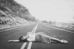 LETS JUST LAY HERE IN THE MIDDLE OF THE ROAD AND WAIT FOR A TRUCK