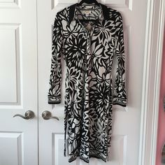"Patterned dress Black and white patterned dress. Long sleeves, removable tie belt, 3 concealed snaps at neckline. Heavy weight knit. Petite size but length is at the knee- I'm 5'9"". Rayon. Talbots Dresses"