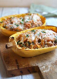 Enchilada-BoatsSpaghetti Squash Enchilada Boats   Ingredients •1 (3 lbs.) spaghetti squash •1 tablespoon coconut oil •1 yellow onion, chopped •2 cloves garlic, minced •2 cups fresh spinach •1 (14.5 oz) can roasted tomatoes with green chiles •1 teaspoon ground cumin •½ teaspoon sea salt •2 ounces goat cheddar, shredded