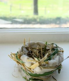 Using baking soda clay to make birds nests with toddlers and preschoolers. These cute bird nest crafts are perfect for spring! Lovely playful nature art!