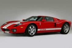 2005 Ford GT 500-hp supercar, and just like in the 1960s, the goal here was to beat Ferrari. This time it was a street brawl between the GT and the Ferrari 360 Modena. The Ford was quicker in every speed contest and could top 200 mph. Today, the GT's values have increased well beyond the original sticker of around $150,000.