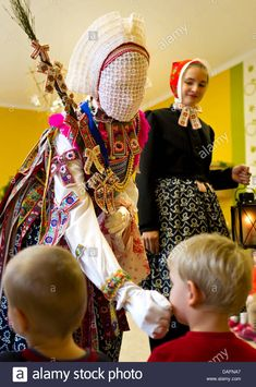 """Stock Photo – The traditionally dressed Sorbian Christkind with veiled face and escorted by two girls visit the children of the childcare center """"Pfiffikus"""" om Schleife, Germany, 06 December – Presents for girls Authentic Costumes, Presents For Girls, Two Girls, Baby Clothes Shops, Childcare, Baby Toys, Lifestyle Blog, Portrait Photography, Germany"""
