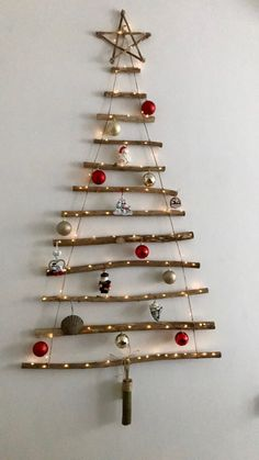 25 Classic Christmas Wall Trees To Copy Right Now 4 - Weihnachten Hanging Christmas Tree, Ribbon On Christmas Tree, Wooden Christmas Trees, Xmas Tree, Rustic Christmas, Simple Christmas, Christmas Crafts, Christmas Ornaments, Kids Christmas