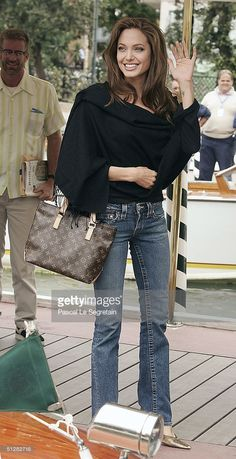 Actress Angelina Jolie arrives for the 'Shark Tale' Photocall at the 61st Venice Film Festival on September 10, 2004 in Venice, Italy.