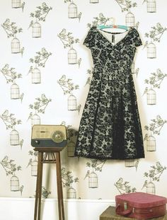 The Wallpaper, the dress and the vintage suitcase.