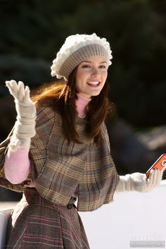 white grey beret, off white wrist gloves, light pink turtleneck, brown plaid capelet, waist high full skirt