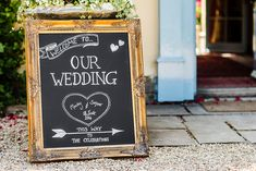 Blackboard direction sign - An outdoor DIY wedding ceremony in Cambridgeshire England with bright blue colour scheme, huge balloons, many rustic home made touches, dress by Allure Bridals