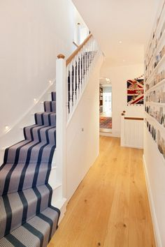 Interior staircase ideas striped stair runners light wood flooring recesses lights