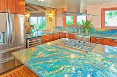 Van Gogh solid slab granite counter tops. I love the counter tops but for my taste it's a little overdone.  I would put it on the island and more neutral counter tops everywhere else.  White cabinets instead.