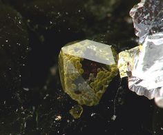 Very small spheres of yellow iridescent goethite included in quartz.  En Bournegade (Embournegade), Alban - Curvalle, Alban - Le Fraysse area, Tarn, Midi-Pyrénées, France