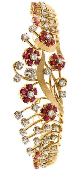 Ruby, diamond and 18 karat yellow gold tiara, with 57 round diamond weighing 7.70 carats, 1 old European cut diamonds weighing 0.45 carats and 47 round rubies weighing 4.25 carats . Circa 1940's