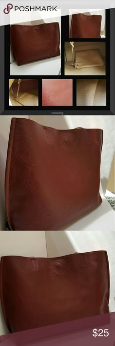 """Carryall Tote w/Extra Tote This is a great pebbled faux leather reverseable bag is done in a nice rich red and tan combo. This bag also has a zippered tote inside for your keys, phone, or makeup. This bag was used for about a month, and is in EUC!  Dimensions:  21""""L x 13""""H x 5.5""""D. JustFab Bags"""