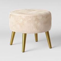 This ottoman features a circular design with a soft and fuzzy faux-fur fabric that creates comfortable texture. It has four angled, shiny gold legs that create a bold pop of contrasting style. Living Room Bench, Living Room Furniture, Living Room Decor, Bedroom Decor, Furniture Decor, Round Ottoman, Ottoman Bench, Modern Ottoman, Painted Stools