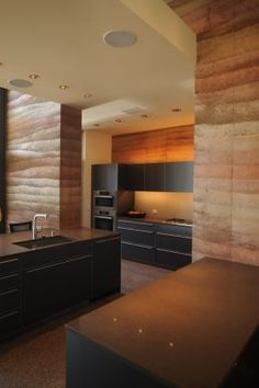 Torcasso Residence Kitchen, Santa Fe by Larry Speck/PSP - rammed earth and glass walls