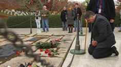 ARLINGTON, VA - NOVEMBER 22: Herman Whalen Jr. of Syracuse, New York, kneels at the gravesite of former U.S. President John F. Kennedy, his wife Jaqueline Kennedy and other family members at Arlington National Cemetery November 22, 2013 in Arlington, Virginia. When he was a boy in 1963, Whalen and his family layed a wreath at the gravesite. Remembrance ceremonies will be held arcoss the United States today, the 50th anniversary of the assisination of President Kennedy. (Photo by Chip…