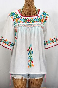 """Without a doubt, our most popular peasant blouse:  The """"La Marina"""" Embroidered Mexican Blouse in Classic White with Fiesta Embroidery.  #bohemian #hippie #summer #siren #fashion #vintage #boho #cincodemayo"""