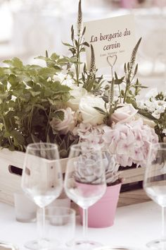 Dinner wedding centerpiece with wood boxes and natural soft flower decorations