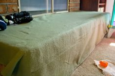 Babyproof the hearth. Take thick fleece and sew several strips over the corner area to pad it.