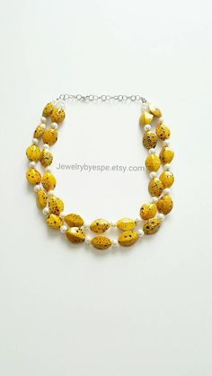 Hey, I found this really awesome Etsy listing at https://www.etsy.com/listing/229055981/yellow-statement-necklaceivory-layered