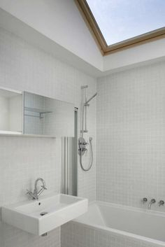 small space maximized by sink, skylight!