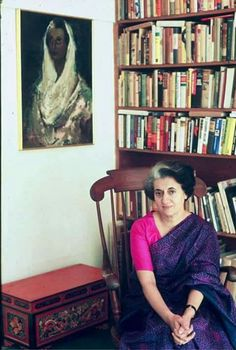 Indira Gandhi under her own portrait.