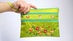 A personal favourite from my Etsy shop https://www.etsy.com/sg-en/listing/246531417/green-boho-bag-embroidery-wristlet