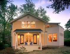 Light yellow traditional house. traditional exterior by Moore Architects, PC