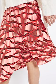 Add a quirky-cool feel to your repertoire in this unique asymmetrical hem midi skirt. In a red base, it comes with an all-over matchstick print. Style with a white knit and slider sandals for transitional look. Topshop
