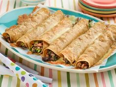 Get Turkey and Spinach Taquitos Recipe from Food Network