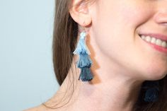 Hello, summer tassel earrings. If you like to put some fun fringe on like I do, you're in luck! Throw some easygoing tassels on pretty much everything this summer. Try wearing tassels in a new way with these DIY ombre stacked tassel earrings. It only takes about an hour to make them. DIY Ombre Stacked …