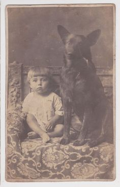 Rustical boy with Black German Shepherd - dog 1920's