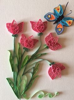 Pink tulips with a butterfly