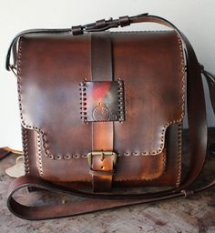 This purse/bag is a great fusion of rustic design.  Depending on the interior and if there are any internal pockets this would take me about a week to make for scratch. http://KNcustomLeather.etsy.com