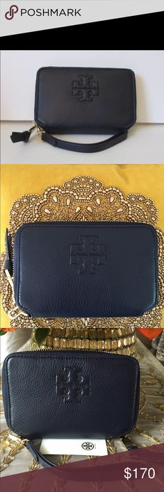 Tory Burch Thea Navy blue Wallet Wristlet Tory Burch Thea Multi-task Navy blue Smartphone Wallet Wristlet zipper gold logo.  Brand new with tags.  Perfect matching set to the navy blue Thea purse posted in my closet.  Timeless color for any season. Tory Burch Bags Clutches & Wristlets