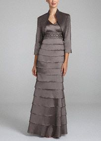 Thereis no doubt that you will lookexceptional in this elegant mother of the bride or groom dress!  Sleeveless bodice features dazzling beaded empire waist.  Long softmulti-tiered stretchtaffeta fit and flare skirt addstexture and is figure flattering.  3/4 sleeve jacket offers just the right amount of coverage when seasons change.  Fully lined. Back zip. Imported polyester/spandex blend. Dry clean only.