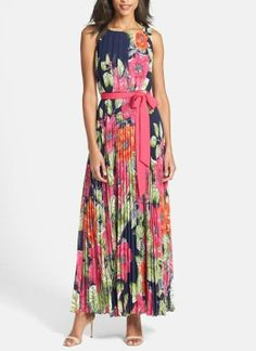 Adoring the pleats and floral prints on this chiffon maxi dress.