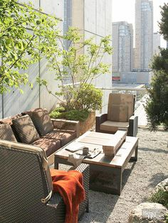 A gravel patio and simple plantings are the perfect choice for this rooftop space above a modern condominium with great city views! http://www.bhg.com/home-improvement/porch/outdoor-rooms/small-outdoor-living-spaces/?socsrc=bhgpin031615rooftopcontemporary&page=7