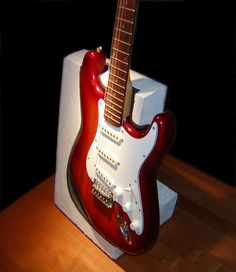 A guitar stand by Flark, on instructables.com. A clever alternate approach to keeping an instrument upright.