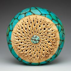 """""""Spiral Stars"""" 10""""h x 10""""w x 4""""d. Carving by Mark Doolittle; paper applique by Kathy Doolittle."""