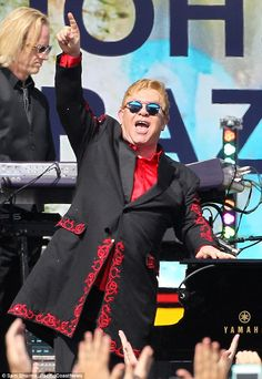 Rocking out: The legendary 68-year-old singer sported a long black jacket with an intricat...