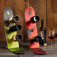 Display your favorite wine with these unique wine racks made of reclaimed skis. Wood Wine Racks, Wine Glass Holder, Unique Wine Racks, Ski Decor, Gifts For Sports Fans, Wine Carrier, Wine Shelves, Bottle Rack, Bottle Opener