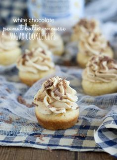 miniature sugar cookie cups that are filled with a peanut butter mousse and garnished with chocolate shavings.