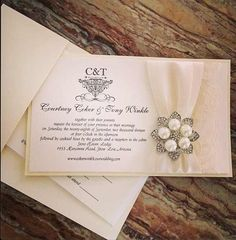 Stephita wedding invitation #lace#satin#brooch#elegant This is the invite I picked :) And I won't change a thing about it. I love love love love it!