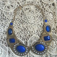 NEW Gold and Blue Stone Collar Necklace NEW without tag! Never worn! Gold details of chains and links make this necklace a statement piece! Blue stones and clear rhinestones. Clasp closure. Jewelry Necklaces